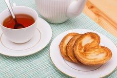 Tazza di tè con i biscotti Fotografie Stock Libere da Diritti