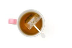 Tazza di tè con la bustina di tè Fotografia Stock