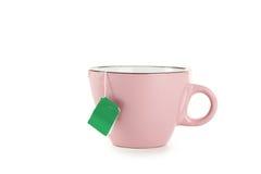 Tazza di tè con la bustina di tè isolata su un bianco Fotografia Stock