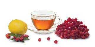 Tazza di tè, del limone e delle bacche sani del viburno Fotografia Stock
