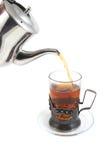 Tazza di tè di cristallo riempita fotografia stock libera da diritti