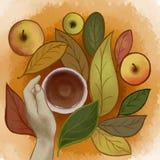 Tazza di tè a disposizione sui precedenti delle foglie e delle mele di autunno illustrazione di stock
