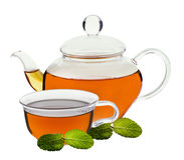 Tazza di tè e della teiera Fotografia Stock Libera da Diritti