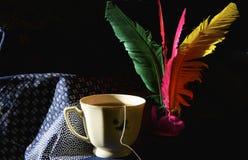 Tazza di tè e di volano fotografia stock