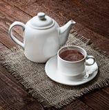 Tazza di tè e teiera Fotografia Stock