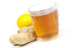Tazza di tè nero con lo zenzero ed il limone Fotografie Stock Libere da Diritti