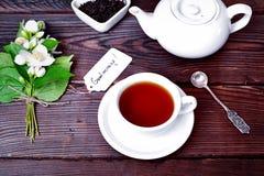 Tazza di tè nero e del fabbricante di birra Fotografia Stock Libera da Diritti