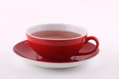 Tazza di tè rossa Immagine Stock