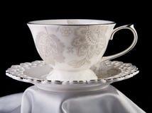 Tazza di tè su fondo nero Immagine Stock