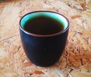 Tazza di tè su legno immagini stock libere da diritti