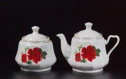 Tazza di tè su un fondo nero Fotografie Stock Libere da Diritti