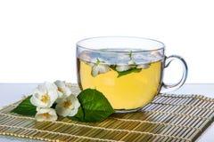 Tazza di tè sulla stuoia fotografie stock