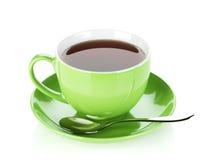 Tazza di tè verde con il cucchiaio Fotografie Stock Libere da Diritti