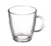 Tazza di vetro vuota di tè con la maniglia isolata su fondo bianco fotografia stock