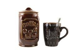 Tazza e contenitore di caffè Fotografie Stock Libere da Diritti