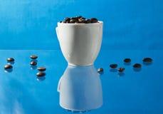 Tazza e fagioli di caffè Fotografie Stock