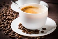 Tazza e fagioli di caffè. Immagine Stock