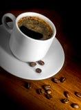 Tazza e granuli di caffè Fotografie Stock