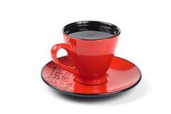 Tazza e piattino rossi Fotografie Stock