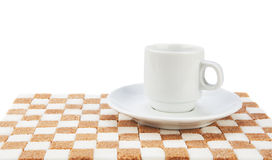 Tazza e piattino su un supporto di zucchero Immagini Stock