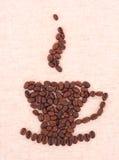 Tazza fatta dei fagioli di cofee Immagini Stock