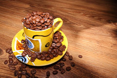 Tazza in pieno dei fagioli del coffe Fotografie Stock
