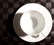 Tazza rotonda su un piattino Fotografia Stock Libera da Diritti