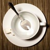 Tazza rotonda su un piattino Fotografie Stock Libere da Diritti