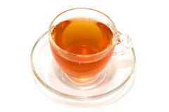 Tazza trasparente di tè su una priorità bassa bianca Fotografia Stock Libera da Diritti