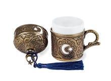 Tazza turca di cofee su fondo isolato bianco Immagine Stock