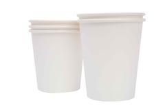 Tazze bianche del cartone per le bevande calde Fotografie Stock Libere da Diritti