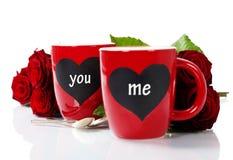 Tazze del biglietto di S. Valentino Immagini Stock