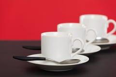 Tazze del caffè espresso su un contatore Fotografia Stock