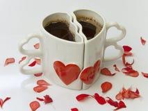 Tazze di caffè a forma di del cuore Fotografie Stock