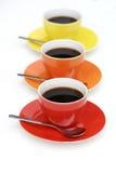 Tazze di caffè nella riga. Immagine Stock