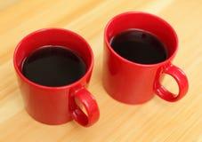 Tazze di caffè rosse Fotografia Stock