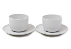 Tazze di caffè su un bianco Fotografia Stock