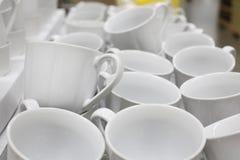 Tazze di tè bianche messe Fotografia Stock