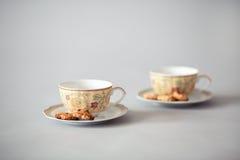 Tazze di tè con i biscotti Fotografia Stock