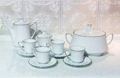 Tazze di tè con una teiera Fotografia Stock