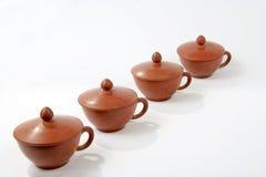 Tazze di tè dell'argilla con i coperchi Fotografia Stock