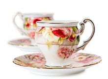 Tazze e piattini di caffè decorati con i fiori Fotografia Stock
