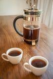 Tazze e tuffatore bianchi del caffè immagine stock