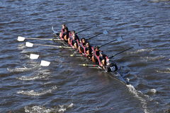 TBC Racing Crew races in the Head of Charles Regatta Men`s Youth Eights Royalty Free Stock Images