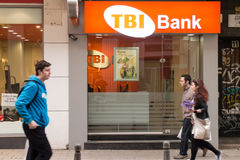 TBI Bank branch in Sofia, Bulgaria. People passing by TBI Bank branch in Sofia, Bulgaria royalty free stock photos