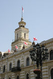 Tbilisi. Office building in city center, flags and a street lantern Stock Photo