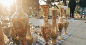 Tbilisi, Georgia. Close view of eastern jugs in shop flea market of antiques old retro vintage things on dry bridge in