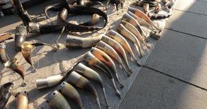 Tbilisi, Georgia. Drinking horns in flea market of old retro vintage things on dry bridge