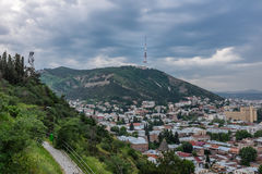 Tbilisi TV Tower Georgia Europe. Tbilisi, Georgia, Eastern Europe. City view from Narikala with Tbilisi TV Tower on the hilltop behind Royalty Free Stock Photo