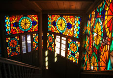 TBILISI, GEORGIA - JANUARY 3, 2016: Interior of an old house with mosaic stained-glass windows and sun lights inside Stock Photo